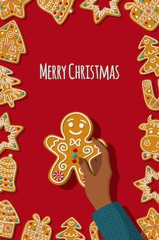 Hand houdt een speculaaspop zelfgemaakte koekjes