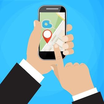 Hand houdt smartphone met stadsplattegrond vast