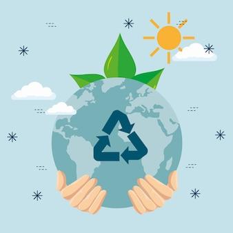 Hand met aarde planeet en ecologie bladeren