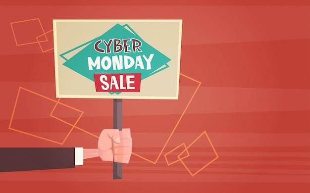 Hand met banner met tekst cyber maandag verkoop aanbiedingen design online