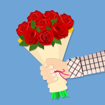 Hand met boeket roze bloemen.
