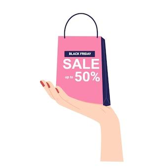 Hand met boodschappentas. zwarte vrijdag verkoop banner.