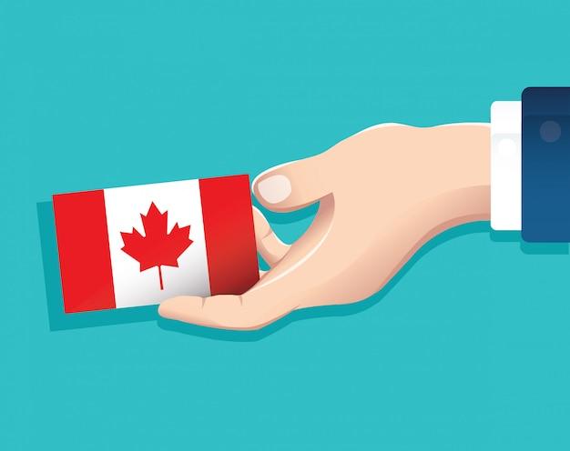 Hand met canada vlag kaart