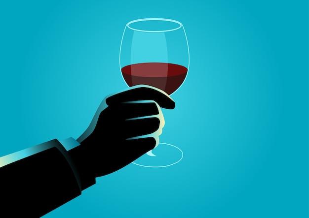 Hand met een glas wijn