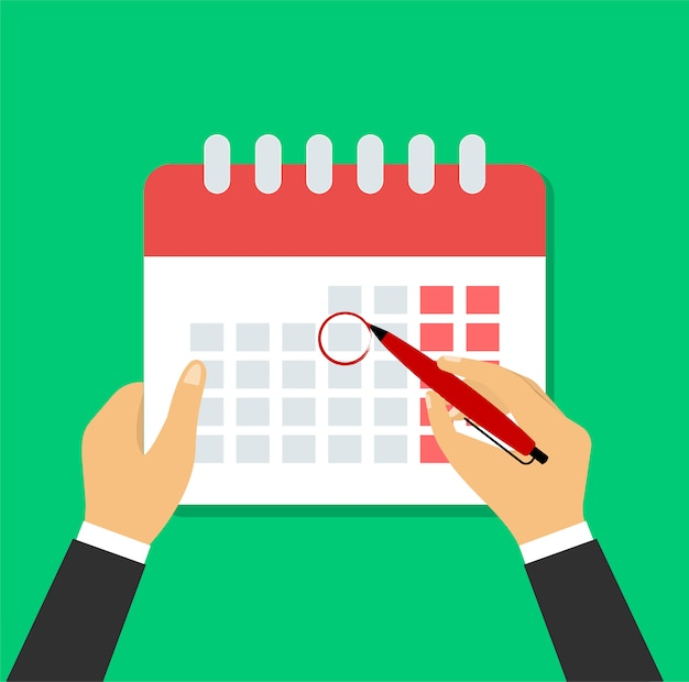 Hand met een pen markeert een geplande dag in de kalender.