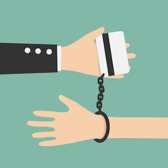 Hand met handboeien aan een credit card