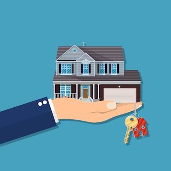 Hand met huis en sleutels