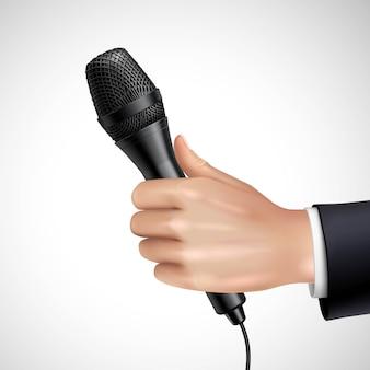 Hand met microfoon