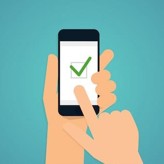 Hand met mobiele slimme telefoon met check app.