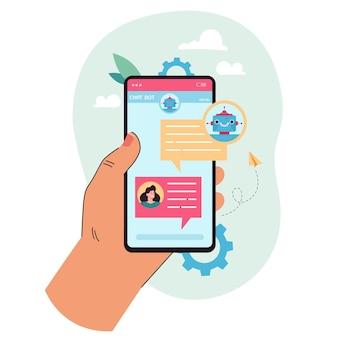 Hand met mobiele telefoon met chatbot op het scherm