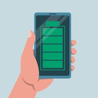 Hand met mobiele telefoon met een volle batterij-teken erop