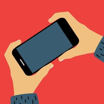 Hand met mobiele telefoon met lege schermsjabloon. kan worden gebruikt voor advertenties.