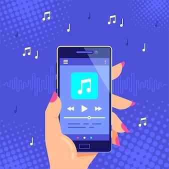 Hand met moderne telefoon afspelen van audio of radio. gebruikersinterface van de smartphone-muziekspeler. mediaspeler-app.