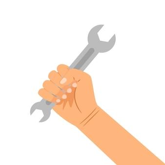 Hand met moersleutel op wit wordt geïsoleerd dat