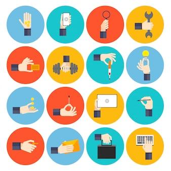 Hand met objecten platte pictogramserie