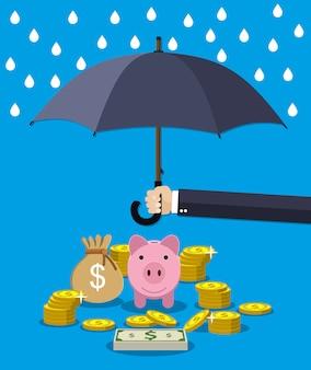 Hand met paraplu onder regen om geld te beschermen.