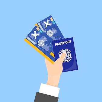 Hand met paspoort en tickets geïsoleerd