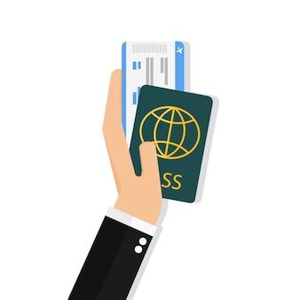 Hand met paspoort en vliegticket