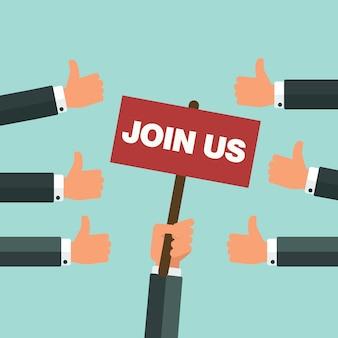 Hand met plakkaat met join us-aankondiging