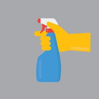 Hand met schoonmaak spray fles