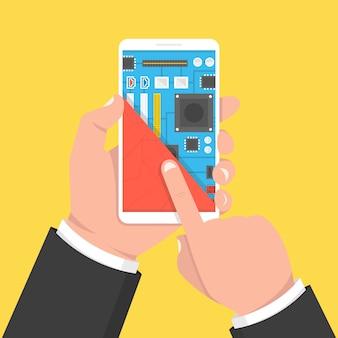 Hand met smartphone met moederbord