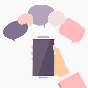 Hand met smartphone met tekstballon. chat concept