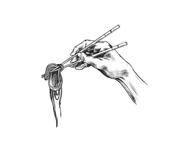 Hand met stokjes met noedels. japanse aziatische traditionele ramen.