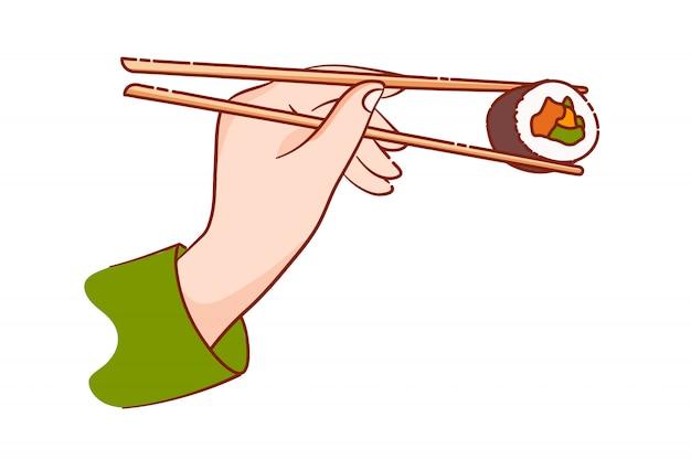 Hand met sushibroodje met paar houten eetstokjes