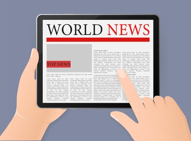 Hand met tablet met wereldnieuws online krant