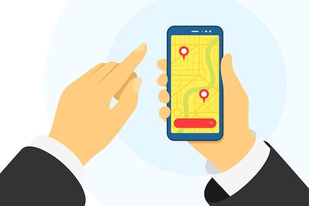 Hand met telefoon en stadsplattegrond met gps-navigatiemarkeringspinnen locatie op scherm mobiel volgen