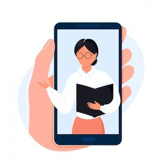 Hand met telefoon met leraar op scherm