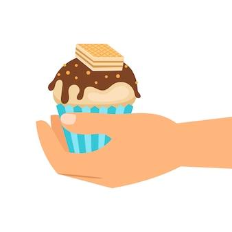 Hand met wafer cupcake
