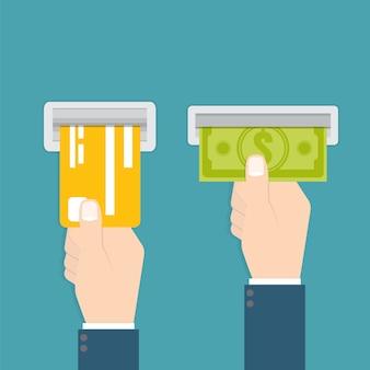 Hand plaatst een creditcard in de geldautomaat en hand neemt het geld van de geldautomaat