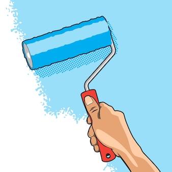 Hand schildert muur met blauwe kleur rolborstel