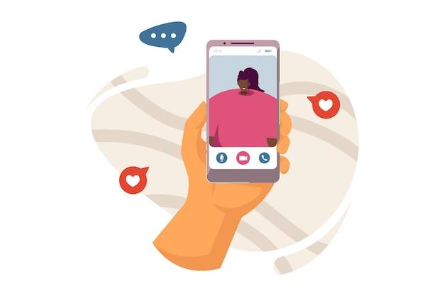 Hand van persoon met behulp van mobiele telefoon voor videogesprek