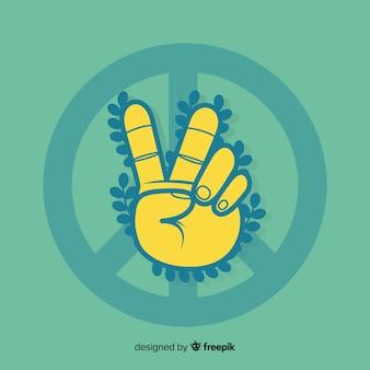 Hand vredesteken met bladeren achtergrond