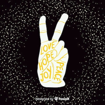 Hand vredesteken met stippen achtergrond