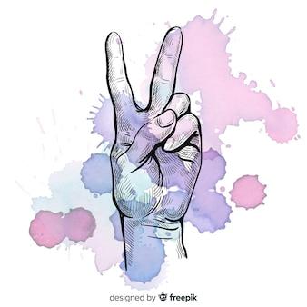 Hand vredesteken met vlekken achtergrond