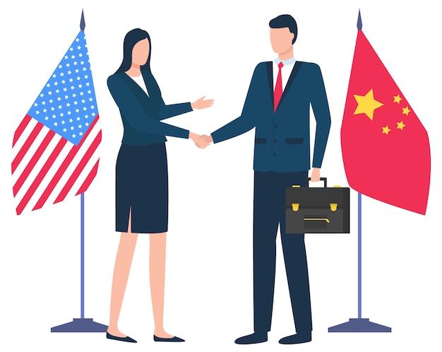 Handdruk van zakenpartners china en amerikaanse vlaggen