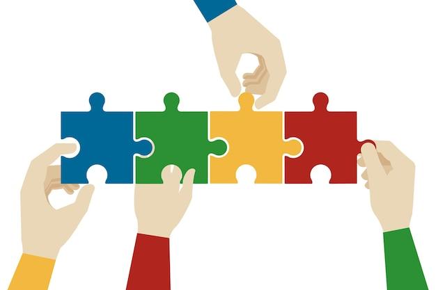 Handen die puzzelstukjes in elkaar zetten.