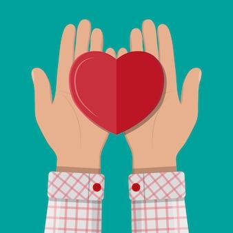 Handen die rood hart geven.