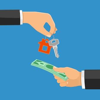Handen die sleutels en geld veranderen