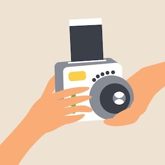Handen houden de camera vast voor directe opnamen Premium Vector