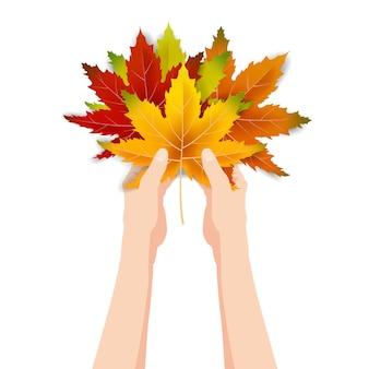 Handen houden kleurrijke herfstbladeren helder boeket herfst, bloemen. hallo herfst belettering