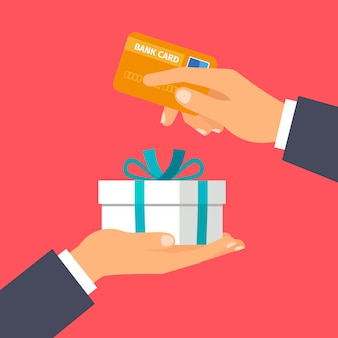 Handen met creditcard en heden