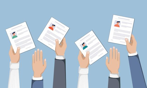 Handen met cv-papieren in de lucht human resources