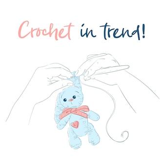 Handen met een haaknaald bunny.