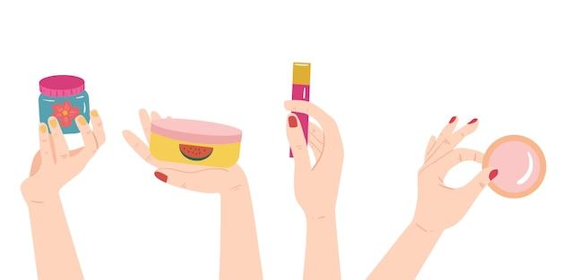 Handen met huidverzorging - cosmetica producten flessen - lotion, crème, serum. huidverzorging, schoonheid, lichaamsbehandeling concept.