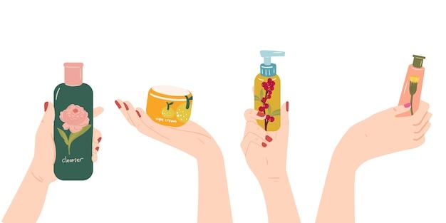 Handen met huidverzorging - cosmetica producten flessen - lotion, crème, serum