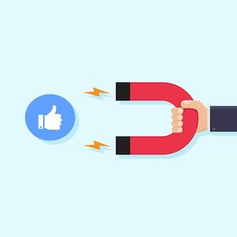 Handen met magneten en zoals pictogrammen sociale media
